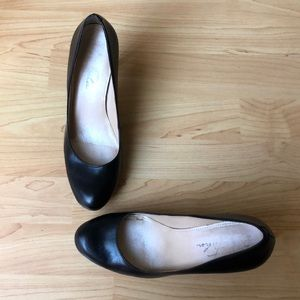 Marc Fisher black leather high heeled pumps.
